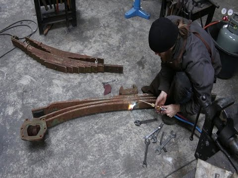Salvaging leaf springs from a semi truck for sword smithing.