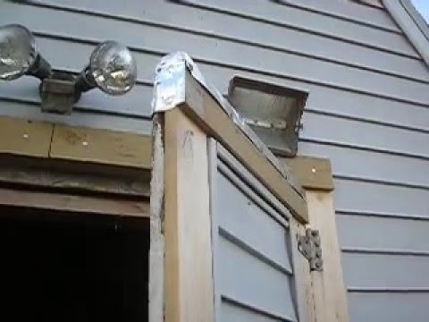 shed doors  -  putting metal flashing on door tops to protect the wood