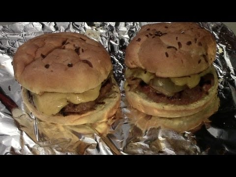 Brat Burgers with Onions and Cheese Sauce