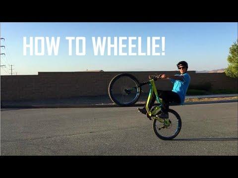 HOW TO WHEELIE A MOUNTAIN BIKE IN 3 EASY STEPS! | Mountain bike skills
