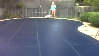 walking across the pool cover