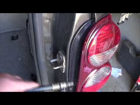 How To Replace Tail Light Bulb Jeep Liberty 2005 - 2007