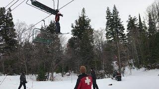 girl almost falls off ski lift..