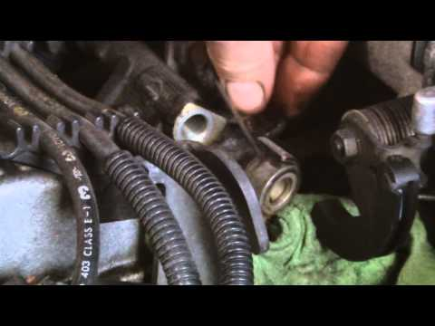 TOYOTA ENGINE REPAIR,changing a faulty fuel injector