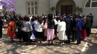 Zimbabwean opposition MPs stage parliament walkout