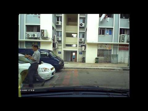 Plain clothes carpark attendant in Singapore