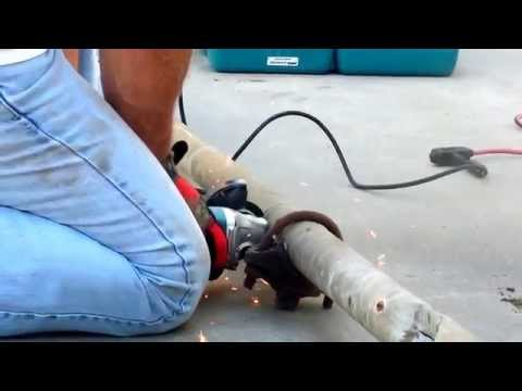 Cutting cast iron drain pipe with a grinder