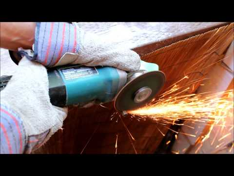 Makita Angle Grinder in Action Cutting Stainless Steel Rod