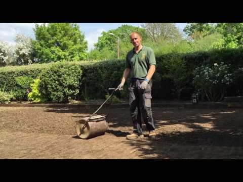 How To Strip an old mossy lawn add new topsoil then lay new turf