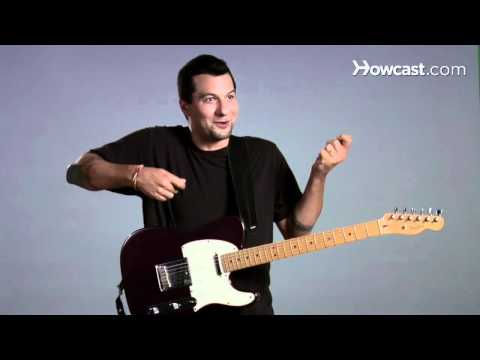 How to Hold a Guitar While Standing | Guitar Lessons
