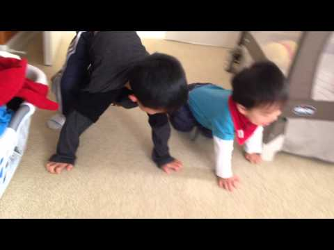 Boy and Baby Brother Crawling on Floor