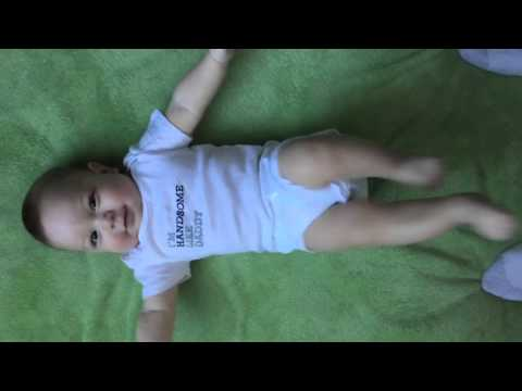 Four month baby kicking his legs happily
