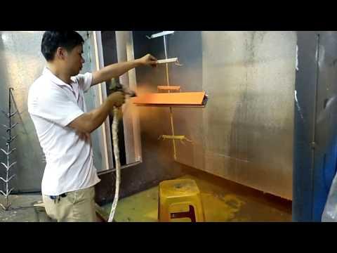 Manual electrostatic paint spraying aluminum profiles