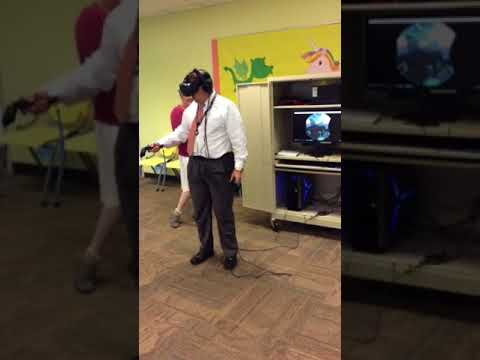 City Manager Rick Davis tries out VR at Baytown Library