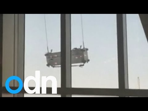 Terrifying video: Window-cleaning cradle swings violently outside 91st floor