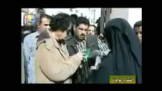 حصرياعلي kas.tvالقذافي يكشف نقاب امراه