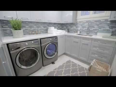 Interior design — Small, Storage-Filled Blue-Grey Laundry Room Renovation