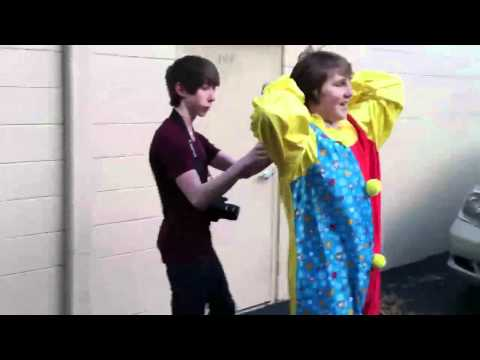 Kid Walking Around In Clown Suit