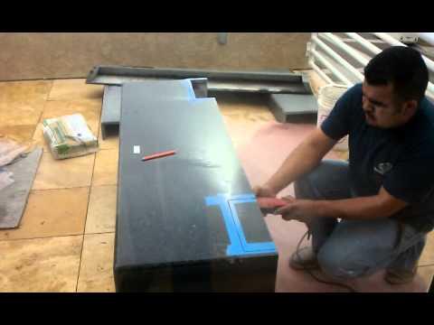 Cutting Uba Tuba Granite for a fireplace.
