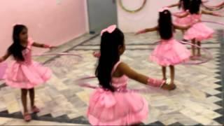 cute kids dance with hula hoop