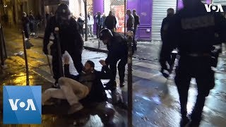 Police Arrest People as Shop is Looted in Paris