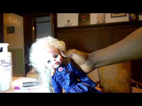 Remove pen marks from doll with Folex