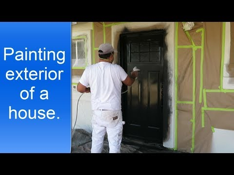 Painting a house exterior.