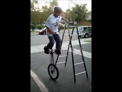 Spencer Riding the Big Unicycle