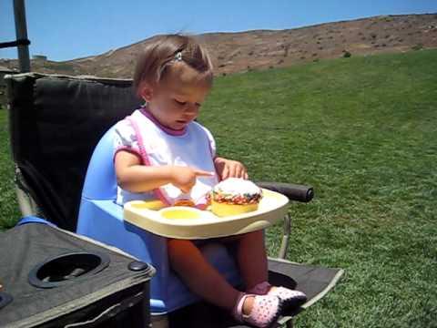 Sadie's 1st Birthday in San Diego Eating a Dora the Explorer Cupcake.