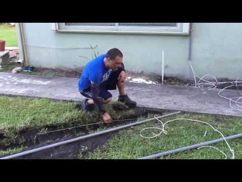 How to trench underneath a concrete sidewalk for security camera cables