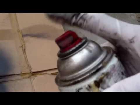 Unclogging enamel spray paint can nozzle
