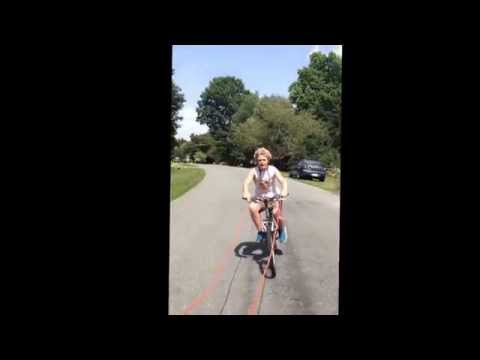 Kid Falls Off Bike Pulled By Car- Seen on MTV