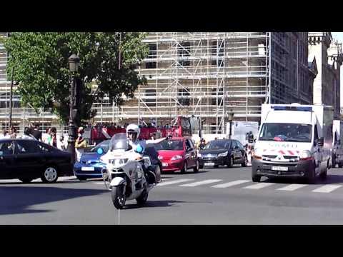 Paris Police Motorbikes Escort Two Ambulances in Traffic.