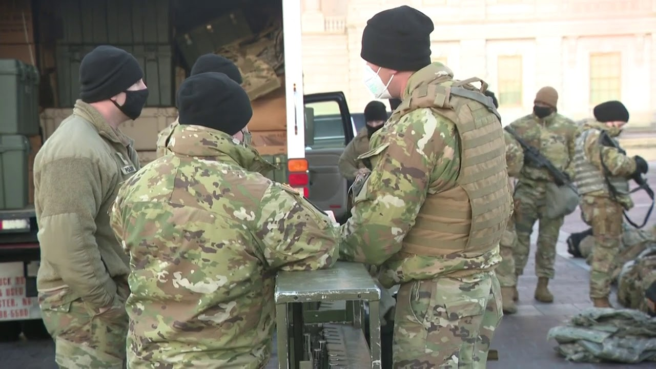 National Guard members in Capitol receive weapons