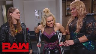 Nia Jax and Ronda Rousey check on Natalya in the trainer
