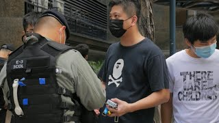 Police search people in Hong Kong after Beijing imposes security law | AFP