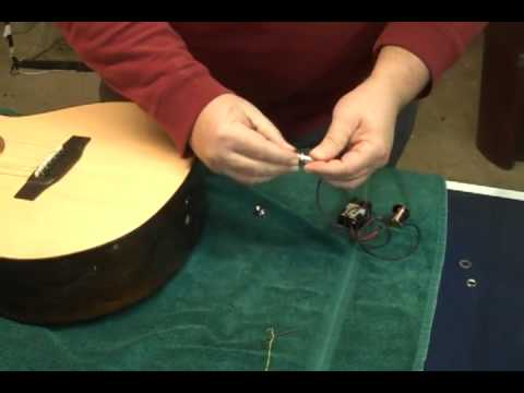 Installing an end pin jack in an acoustic guitar