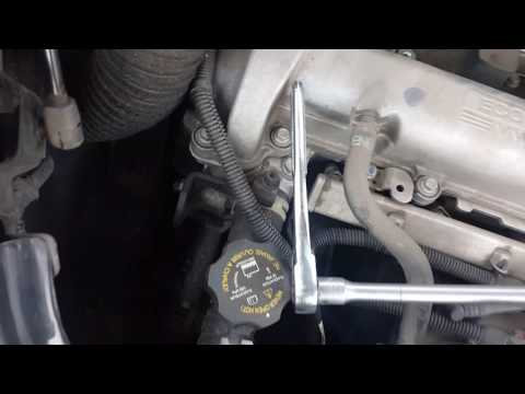How to replace a spark plug in a 4 cylinder chevy engine