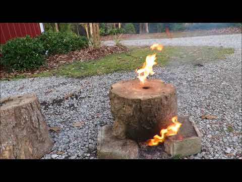 Jet rocket fire logs? I found two hollow logs and made a rocket stove. Last hours. Neat fire trick.