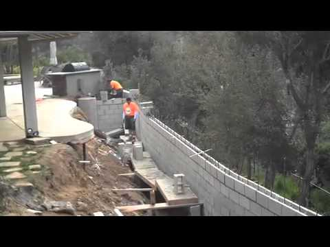 Los Angeles General Contractor: Hillside retaining wall fails - why and how to fix it.