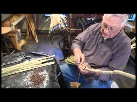 Making a broom by hand with broom corn.