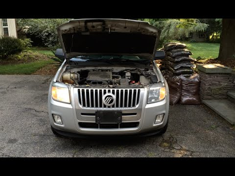 HOW TO: Ford Escape / Mercury Mariner / Mazda Tribute Headlight Bulb Replacement (2008-12)