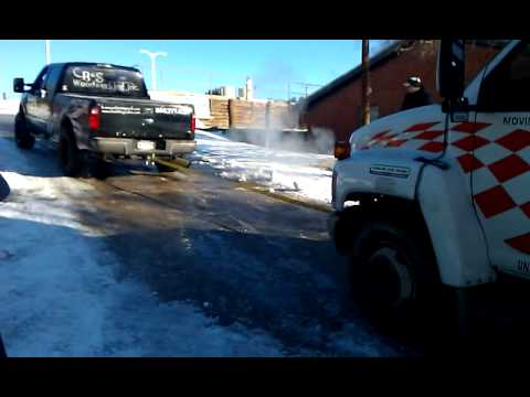 trying to get up a icy hill in a U-haul truck