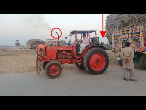 Belarus 510 Tractor Pulling Heavy Sugarcane Load on Road