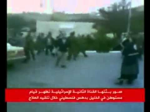 Israeli Colonist repeatedly runs over wounded Palestinian Man Warning  graphic Footage