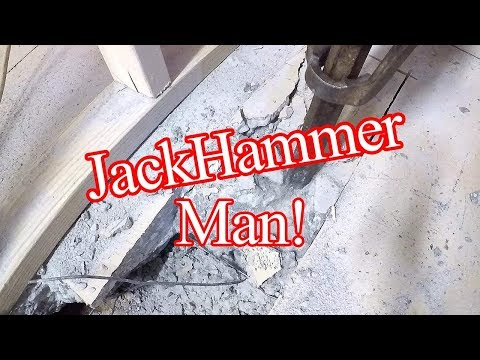 Man looses It With A JackHammer!