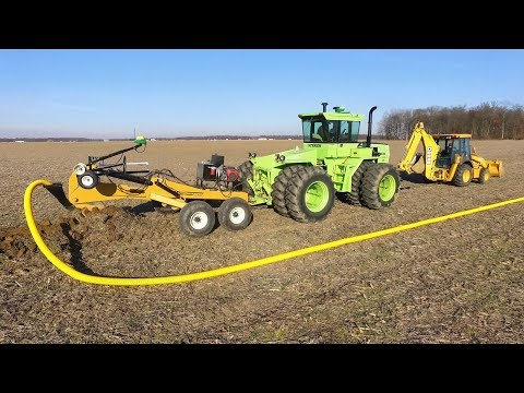 Tiling with a Soil-Max Stealth ZD plow and Steiger Panther