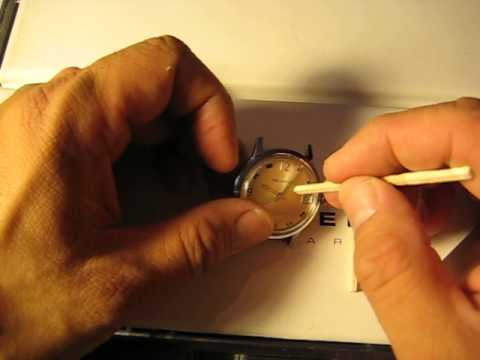 Using sticks to clean a watch case