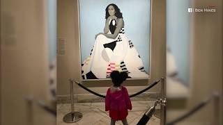 Toddler mesmerised by Michelle Obama painting
