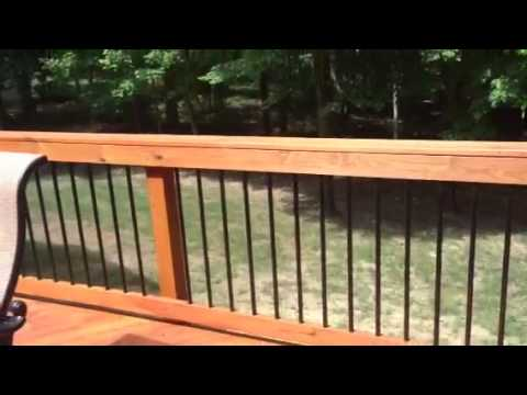 Pressure treated wood deck with lattice and Deckorator Metal Pickets Video